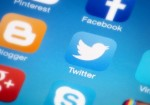 Twitter boosts revenues, but loses money